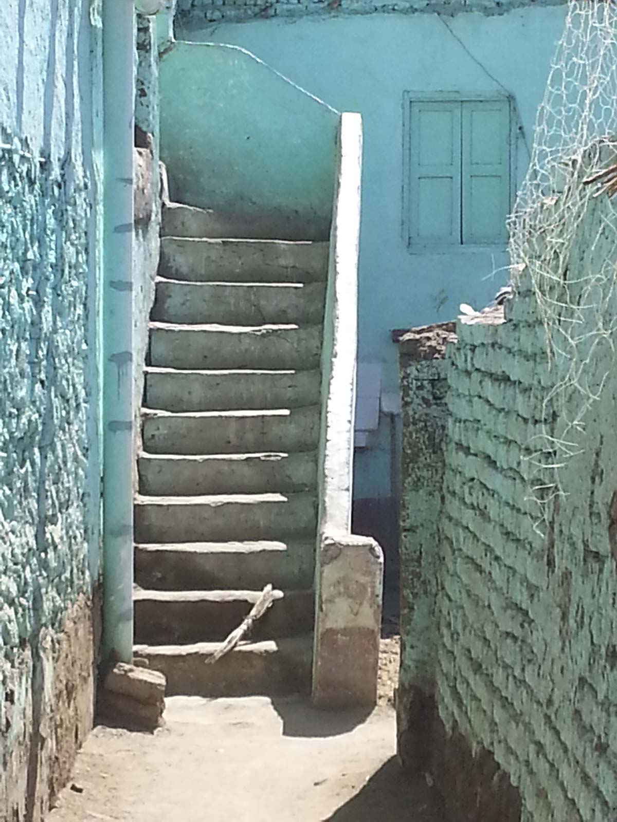 turquoise blue stairs leading to...