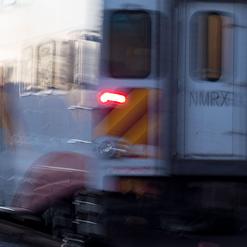 Train in motion leaving station